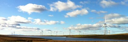 Photograph of windfarm, moorland and loch.