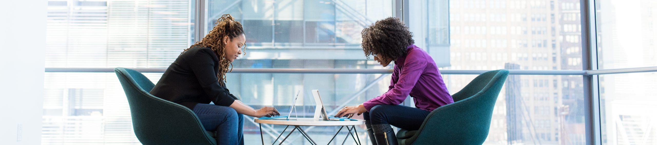 Two black women on laptops