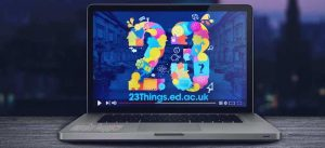 laptop with 23 Things logo background