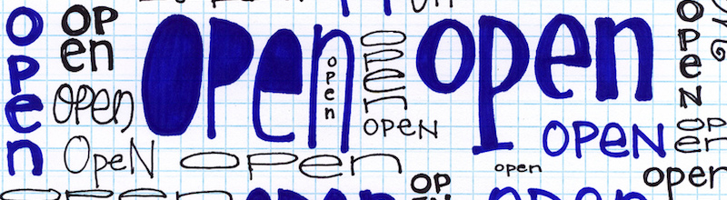 "Paper covered with the word ""Open"" in different sizes"