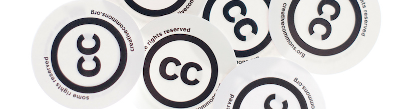 multiple stickers with the Creative Commons logo