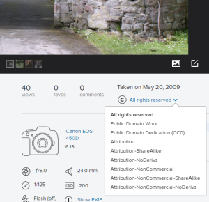 Screenshot of the bottom right corner underneath the individual image display on Flickr. The blue arrow next to the current Creative Commons licence has been clicked and all of the licence options are displayed in a drop down menu.
