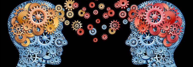 Two heads facing each other made up of cogs and wheels with coloured cogs floating between