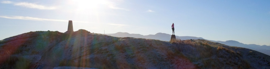 Woman standing on a stone at the top of Blackford Hill