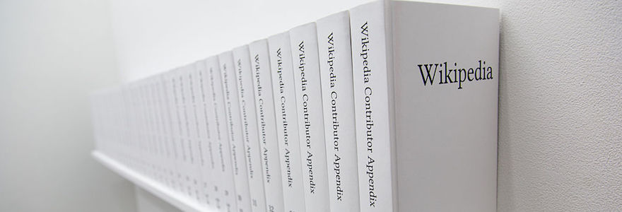 Shelf with a row of books title Wikipedia Contributors (multiple volumes)