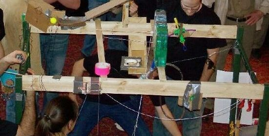 Students working on a rube goldberg machine