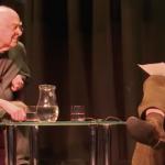Peter Higgs seated opposite Dennis Canavan