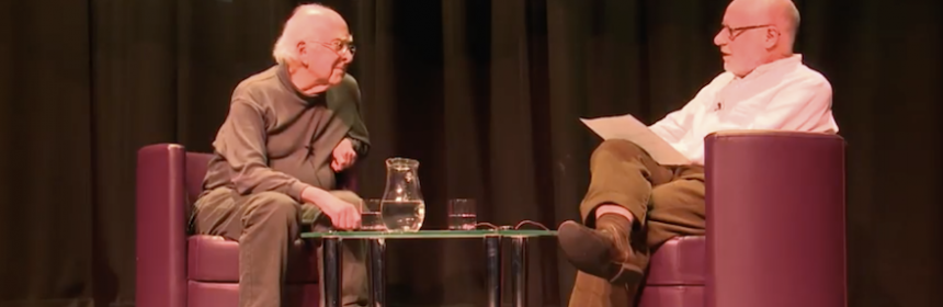 Peter Higgs seated opposite Dennis Canavan