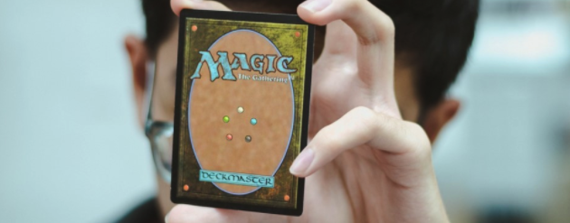 Hand holding a magic the gathering card