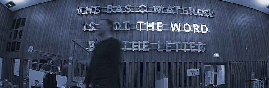 David Forsyth in front of his text based sculpturehe text