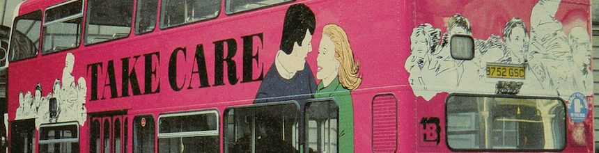 Pink double decker bus with 'Take Care AIDS concerns us all' written on the side