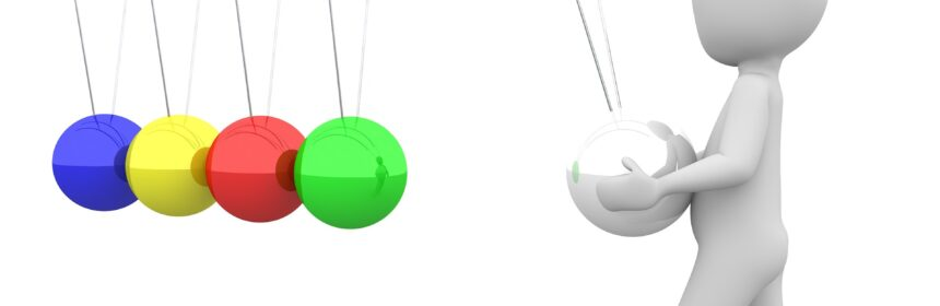 Computer graphics illustration of a person holding and pulling one ball in a colourful newton's cradle