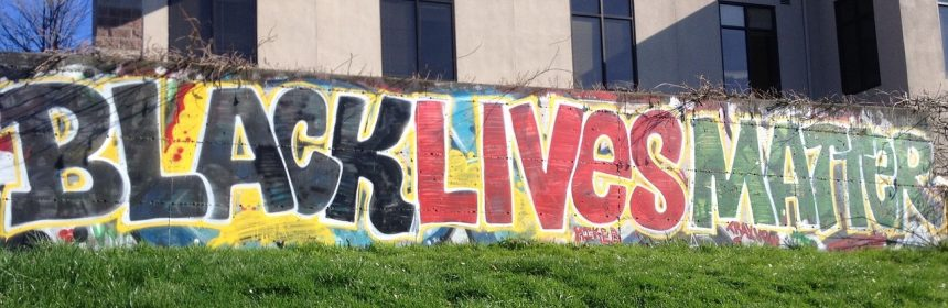Black Lives Matter painted in colourful street art on a wall