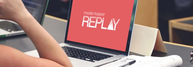 "Laptop displaying the logo ""Media Hopper Replay""."