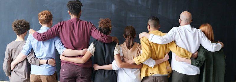 students facing blackboard