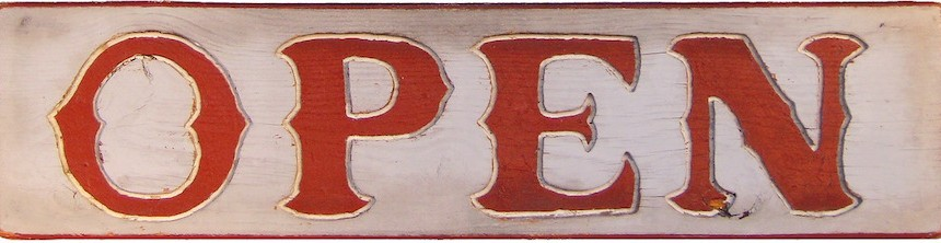 """Weathered sign with red letters """"OPEN"""""""